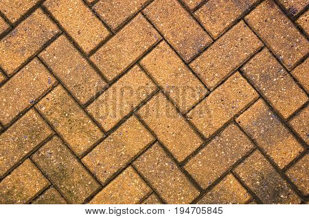 Yellow block paving background for design with copy space