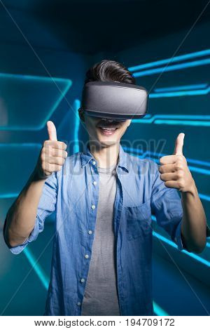man wear vr and thumb up on the technology background