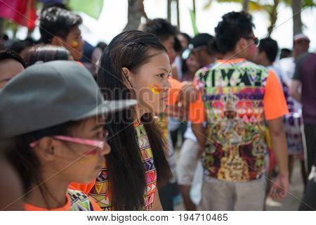 BORACAY, WESTERN VISAYAS, PHILIPPINES - JANUARY 11, 2015: Filipino girl with face painted looking the celebration of Ati-Atihan Festival at White Beach.
