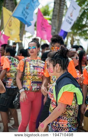 BORACAY, WESTERN VISAYAS, PHILIPPINES - JANUARY 11, 2015: Filipinos dressing orange and sunglasses during Ati-Atihan Festival at White Beach.