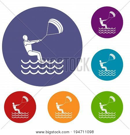 Man takes part at kitesurfing icons set in flat circle reb, blue and green color for web