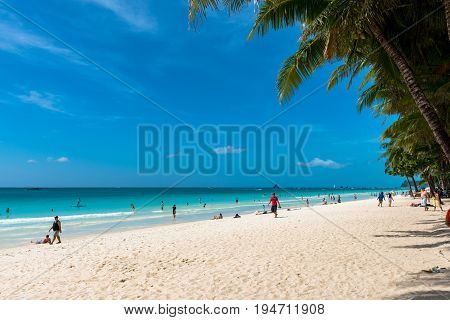 BORACAY, WESTERN VISAYAS, PHILIPPINES - JANUARY 11, 2015: The White Beach of the island of Boracay during hot summer day.