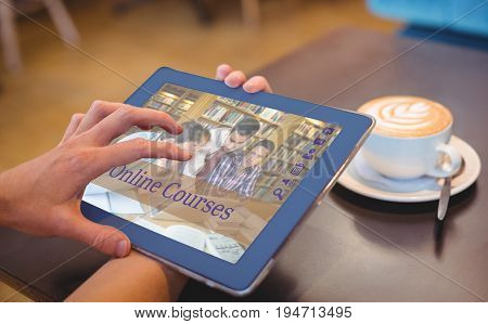 Composite image of online courses against  close-up of digital tablet and coffee on table Close-up of digital tablet and coffee on table in the coffee shop