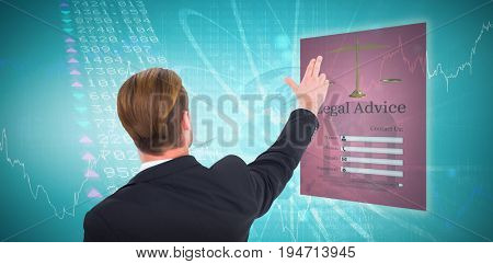 Rear view of businessman pointing with his fingers against stocks and shares