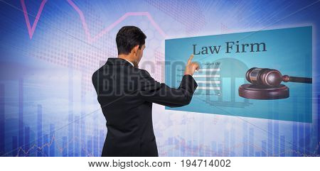 Thoughtful asian businessman pointing against stocks and shares