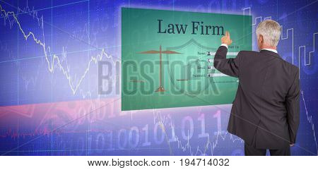 Rear view of stylish mature businessman pointing finger against stocks and shares