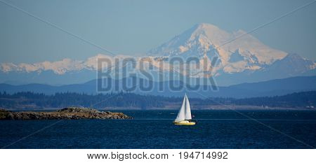 Sailing off Victoria Vancouver Island, BC with Mt. Baker in the distance, WA.