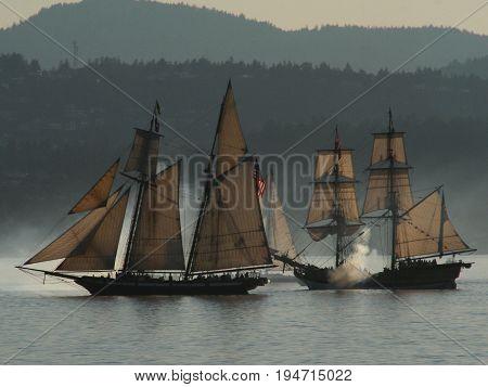 Tall ships off Victoria put on a mock warship display.