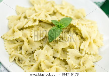 Farfalle Pasta With Pesto Genovese (basil Sauce) On Rustic Wooden Table. Italian Cuisine