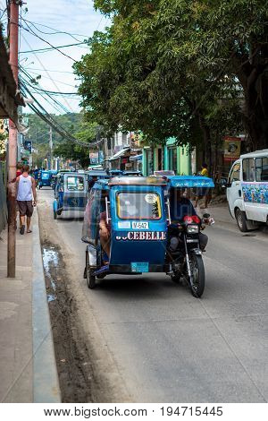 BORACAY, WESTERN VISAYAS, PHILIPPINES - JANUARY 12, 2015: Vertical picture traffic jam of tuk tuk at Boracay Philippines.