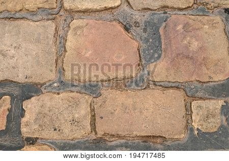 Cobble stone Background set in Black Tar