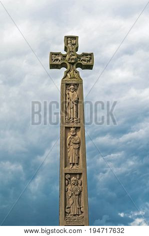 Whitby, North Yorkshire, England - July 13, 2016: Caedmon's Cross - a late Victorian Celtic Cross, in churchyard of St Mary's. In Whitby, North Yorkshire