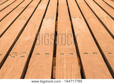 Low perspective image of pier boardwalk planking