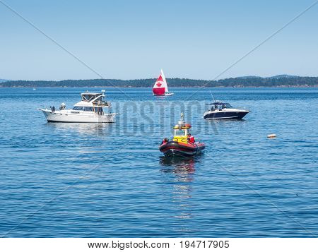 Boats cruise along the coast during Canada 150 anniversary celebration