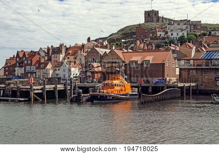 Whitby,England - July 13, 2016: The Whitby R.N.L.I. Lifeboat at its mooring in Whitby harbour on the North Yorkshire coast