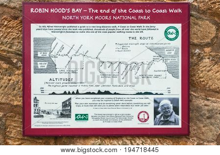 Robin Hoods Bay,England - July 11, 2016:map showing the route of the 192 mile coast to coast walk, made famous by Alfred Wainwright, beginning at St Bees Head Cumbria on England's west coast and ending at Robin Hoods Bay on the east coast, with a photogra