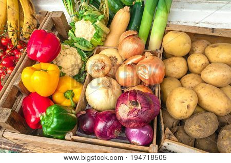 Organic Fruit and vegetables in boxes, background