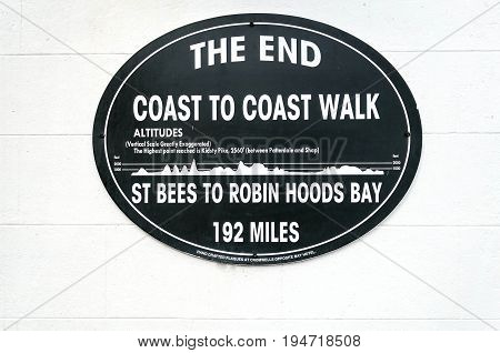 Robin Hoods Bay,England - July 11, 2016: Plaque marking the end point of the 192 mile coast to coast walk, beginning in St Bees Head Cumbria on England's west coast and ending on the east coast at Robin Hoods Bay North Yorkshire