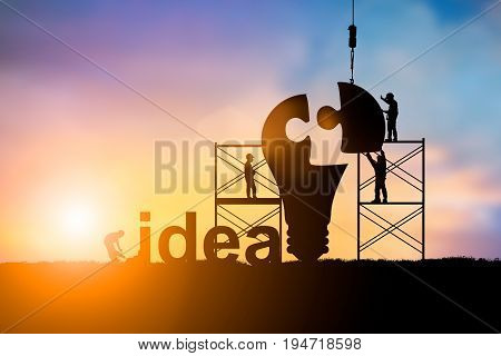Silhouette Team business engineer work connecting jigsaw puzzle piece together. team responsible for the idea of progress over blurred natural.Teamwork potential and motivate employee growth concept