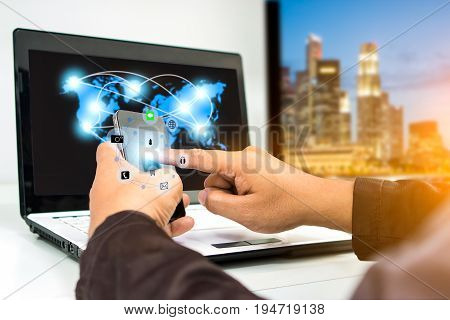 businessman using smartphone upload data to online store Documentation over blurred Distributed threat information to clients for customer network connection .digital technology.select focus
