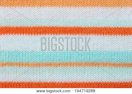 Orange knitting fabric texture background or knitted pattern background. Knitting or knitted background for design. Stripe Line knitting background.