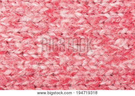 Red and white knitting fabric texture background or knitted pattern background. Knitting or knitted background for design. Red knitting style.