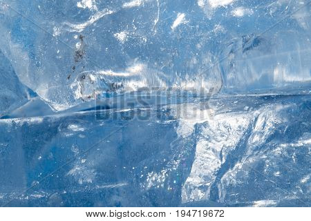 background of cold blue ice . A photo