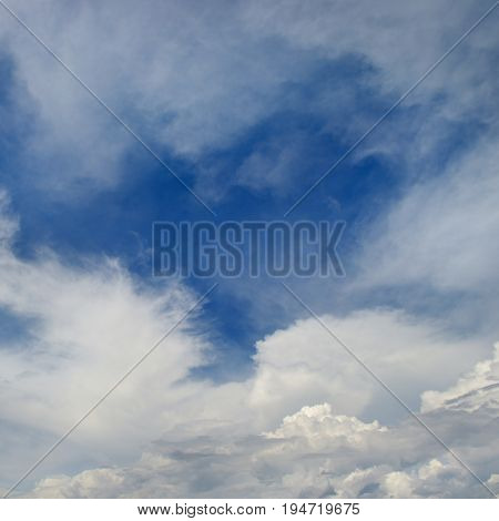 Heavenly seascape. White clouds on a background of blue sky.