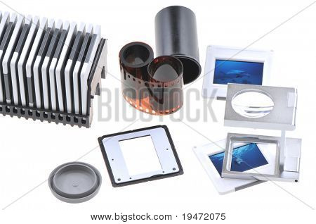 Old timer slide photographer s light box including film, loupe, frames and box. White background studio image.