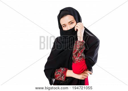 Portrait of young muslim woman with headscarf on a white background. Fashion concept