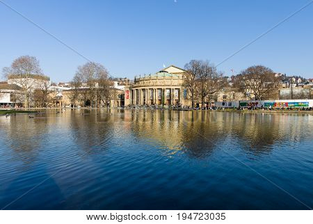 STUTTGART GERMANY - MARCH 18 2016: The Staatstheater Stuttgart (Stuttgart State Theater) and Eckensee pond.