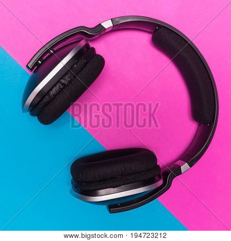 Close up of black Headphones on colorful background.