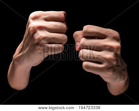 Close up of Male hands on a black background.