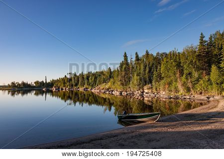 A boat is grounded on the beach on Nutimik Lake in the scenic Whiteshell area of eastern Manitoba, Canada.