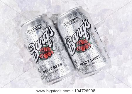 IRVINE CALIFORNIA - JULY 10 2017: Two Barqs Root Beer Cans on a bed of ice with condensation. Created by Edward Barq and still owned by the Barq family but bottled by the Coca-Cola Company.