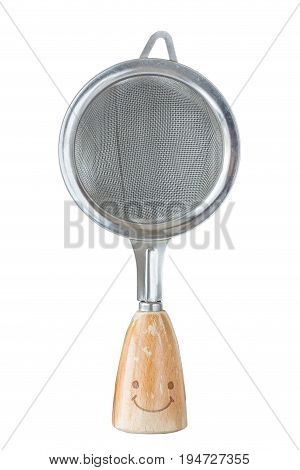 The small sieve colander with wooden handle and smile isolated on white background kitchen utensil concept.