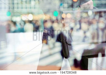 abstract image of business man background, business man and People commuting in rush hour at zebra crossing double exposure. business concept