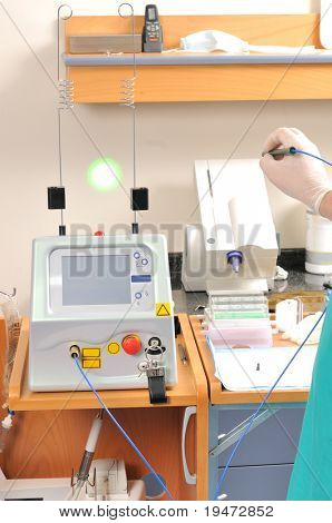 Medical assistants working with multi purpose laser - a series of MEDICAL  related images.