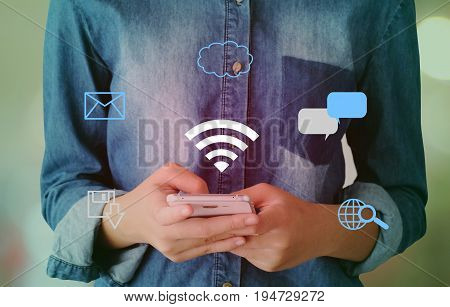Wifi and digital network data icon over hand using smart phone background business and technology concept