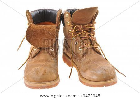 Pair of old yellow working boots. Isolated on white background.