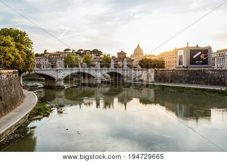 Rome Italy - August 18 2016: Scenic view of Vatican city at sunset from Bridge of Castel Sant Angelo.