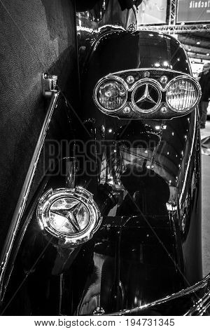 STUTTGART GERMANY - MARCH 17 2016: The rear brake lights of full-size luxury car Mercedes-Benz 770K Cabriolet D (W07) 1931.Black and white. Europe's greatest classic car exhibition