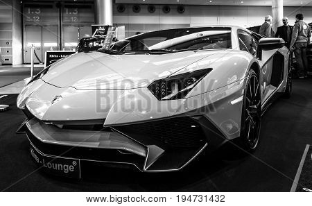 STUTTGART GERMANY - MARCH 17 2016: Mid-engined sports car Lamborghini Aventador LP 750-4 SuperVeloce 2016. Black and white. Europe's greatest classic car exhibition
