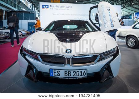 STUTTGART GERMANY - MARCH 17 2016: Plug-in hybrid sports car BMW i8. Europe's greatest classic car exhibition