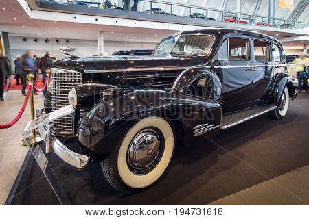STUTTGART GERMANY - MARCH 17 2016: Full-size luxury car Cadillac V16 Series 90 limousine 1939. Europe's greatest classic car exhibition