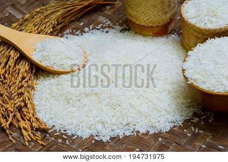 Jasmine Rice, Rice In Wooden Bowl, Basmati Rice, Rice Is On  Wooden Floor As Background.