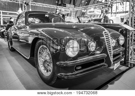 STUTTGART GERMANY - MARCH 17 2016: Vintage car Alfa Romeo 6C 2500 SS Touring Superleggera Coupe 1948. Black and white. Europe's greatest classic car exhibition