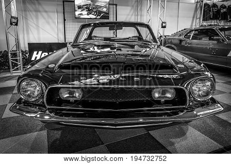 STUTTGART GERMANY - MARCH 17 2016: Pony car Shelby Cobra GT 350 Convertible Tribute 1968. Black and white. Europe's greatest classic car exhibition