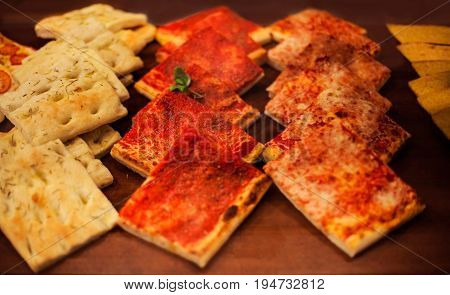 Pizza Take Away pieces Traditional Italian Focaccia with tomatoes black olives and cheese