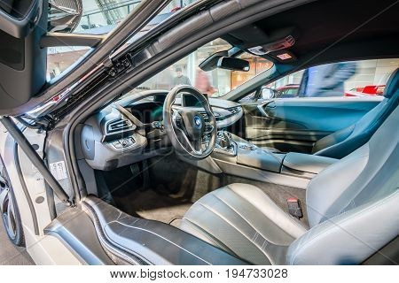 STUTTGART GERMANY - MARCH 17 2016: Cabin of a plug-in hybrid sports car BMW i8. HDRi. Europe's greatest classic car exhibition